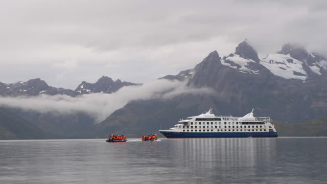 cruise boat with boats transporting passengers in patagonia - patagonia chile stock videos and b-roll footage