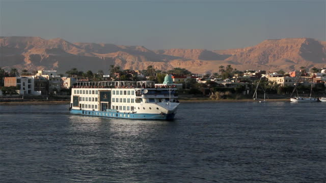 cruise liner makes turn on the river nile - luxor thebes stock videos & royalty-free footage