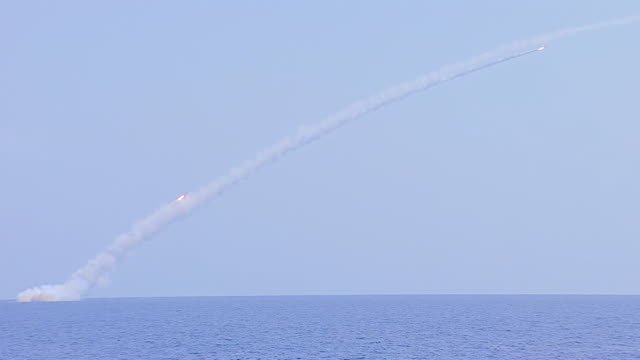 Cruise missiles being launched from a Russian submarine towards Islamic State targets in Syria