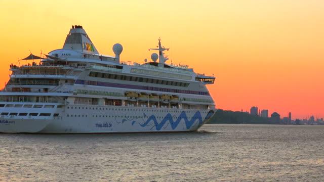 cruise ship AIDA aura at Elbe River, Hamburg-Finkenwerder, Germany