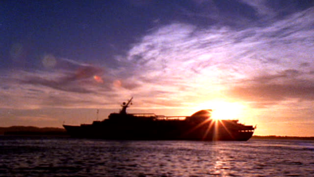 cruise ship at sunset - hd - passenger ship stock videos & royalty-free footage