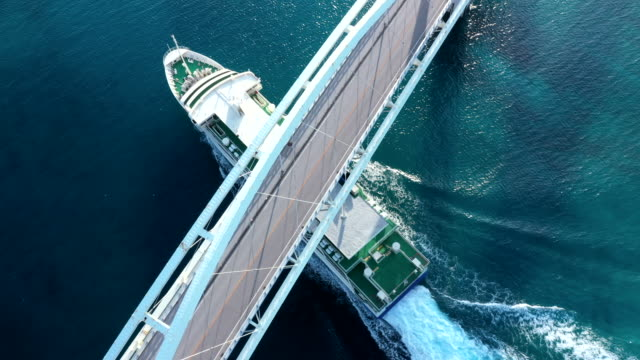 a cruise ship crossing under the bridge - cross stock videos & royalty-free footage
