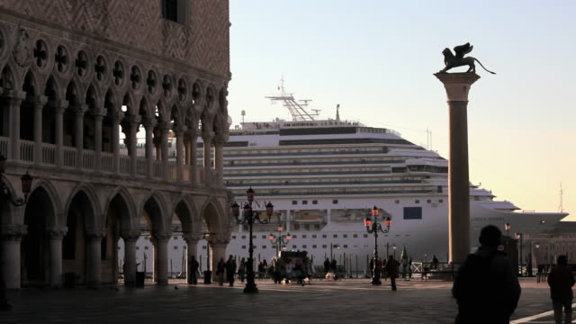 ms cruise ship floating by st marks square / venice, italy - kreuzfahrtschiff stock-videos und b-roll-filmmaterial