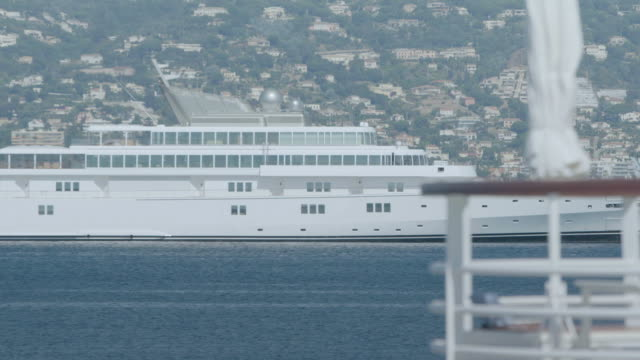 WS Cruise ship moored at harbour, town in background / Antibes, France