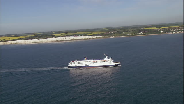 A cruise ship moves through the English Channel near England.