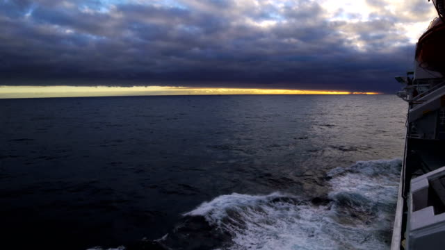 cruise ship on the horizon,antarctica - antarctica sunset stock videos & royalty-free footage