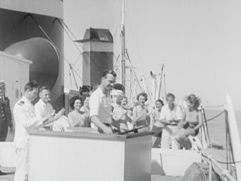 1934 b/w montage ms pan ha ws cruise ship passengers target shooting on ship's deck / gulf of mexico - 1934 bildbanksvideor och videomaterial från bakom kulisserna