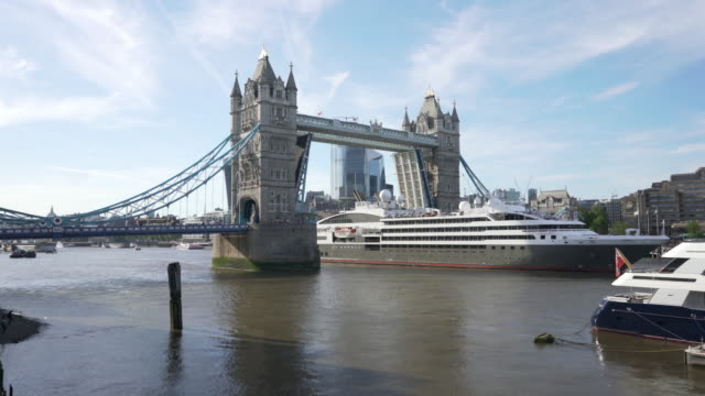 a cruise ship passes through tower bridge - cruise stock videos & royalty-free footage