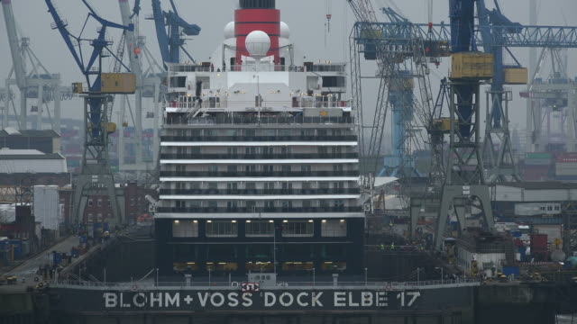 cruise ship queen elisabeth 2 in blohm and voss dock, hamburg, germany - shipyard stock videos & royalty-free footage