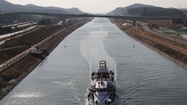 stockvideo's en b-roll-footage met a cruise ship sails along the arabaetgil canal in incheon arabaetgil canal in incheon on march 25 2013 in incheon south korea - incheon