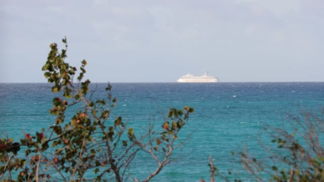 cruise ship sails into caribbean sea on nice day - cuba stock videos & royalty-free footage