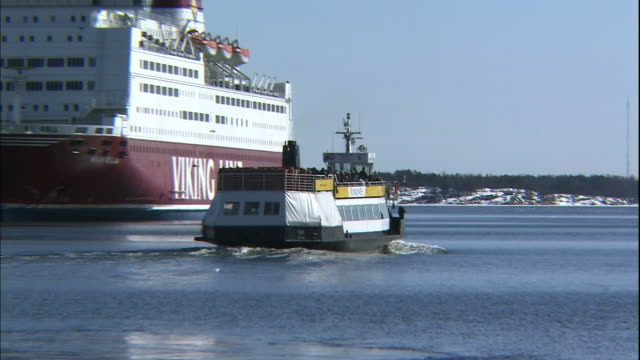 a cruise ship speeds past a viking line vessel in the port of helsinki in finland. - finland stock videos & royalty-free footage