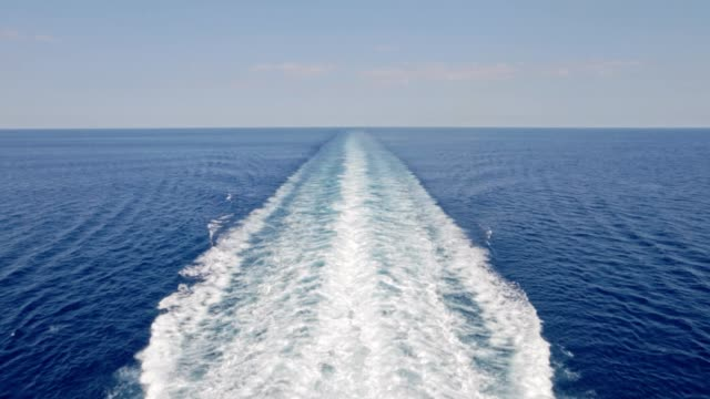 cruise ship trace with calm sea and clear blue sky - cruising stock videos & royalty-free footage