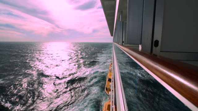 cruise ship wake and pinkish sky from external side cabin - cruising stock videos & royalty-free footage