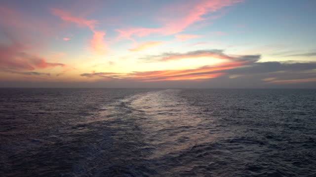 cruise ship wake by sunset - cruise stock videos & royalty-free footage