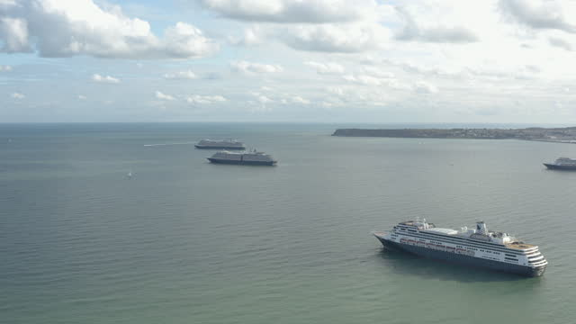 cruise ships anchored off torquay devon aerial view from above water - marina stock videos & royalty-free footage