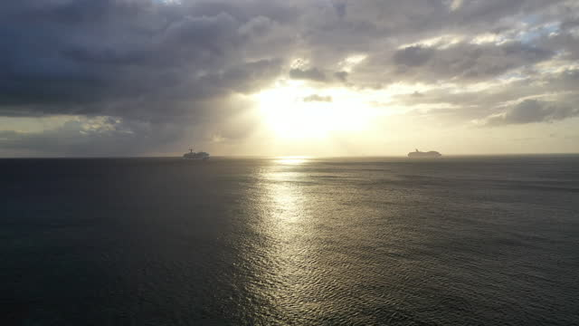 cruise ships at sunset in the caribbean by drone (forward rising) - ship stock videos & royalty-free footage