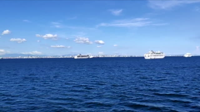 cruise ships, carrying crew and staff members, stranded in manila bay, philippines, due to the coronavirus pandemic and lockdowns - cruise stock videos & royalty-free footage