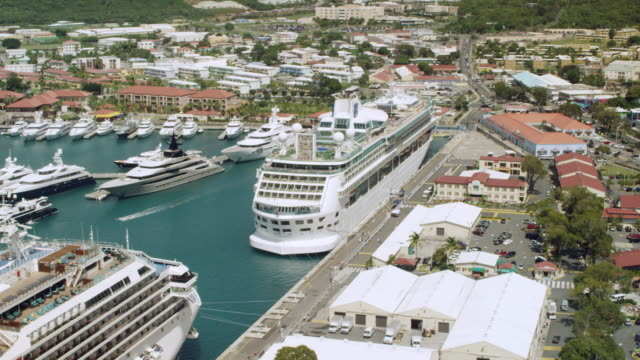 ws aerial pov cruise ships moored at dock / charlotte amalie, st. thomas - virgin islands, united states - cruising stock videos & royalty-free footage
