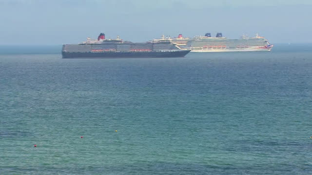 cruise ships moored off the weymouth coast due to the coronavirus pandemic - passenger ship stock videos & royalty-free footage