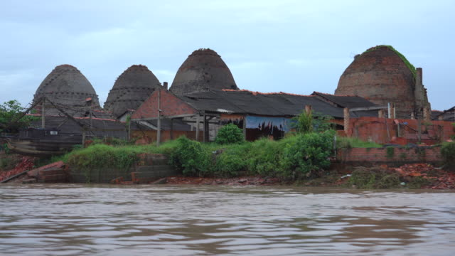 a cruise through the mekong river delta in southern vietnam is full landscape of giant brick beehives oven factory - mekong delta stock videos & royalty-free footage