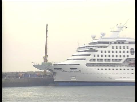 stockvideo's en b-roll-footage met cruiseliner-cargo ship collision; lgv 'norwegian dream' cruiseliner moored at dock pull out tx 25.8.99/nn - seksueel overdraagbare aandoening
