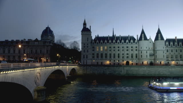 cruiser passing under seine river bridge, night - river seine stock videos & royalty-free footage