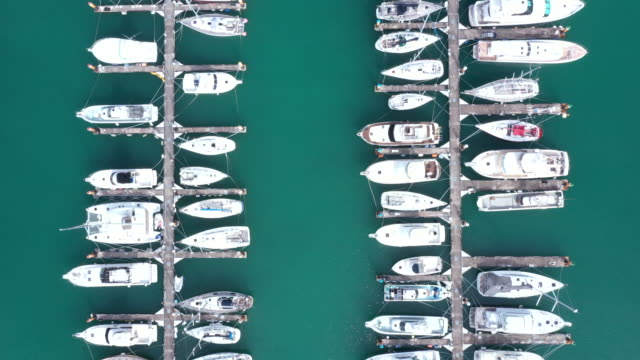 Cruisers lining in small harbor