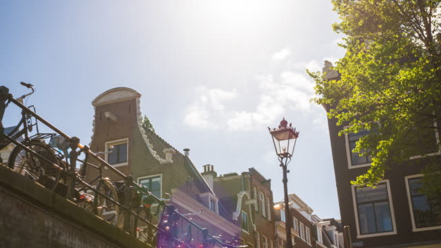 cruising down amsterdam canal on a tourboat, admiring the dutch city life - amsterdam stock videos & royalty-free footage