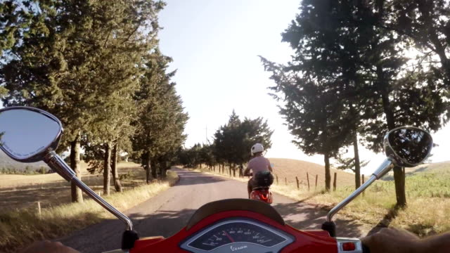 cruising on scooters - motorino video stock e b–roll