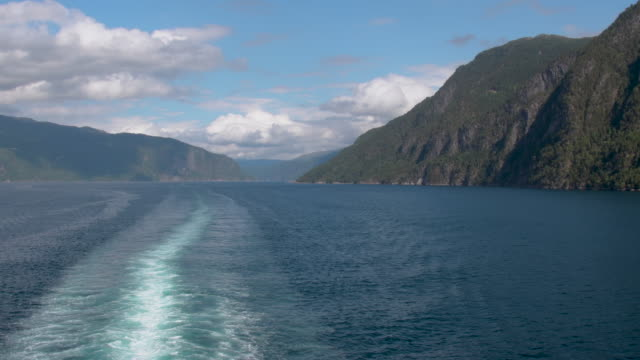 cruising through a fjord in norway looking at the wake - wake water stock videos & royalty-free footage