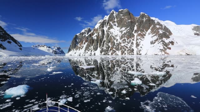 cruising through the lemaire channel on an ice strengthened expedition cruise ship between booth island and the kiev peninsular, antarctica. - cruise stock videos & royalty-free footage