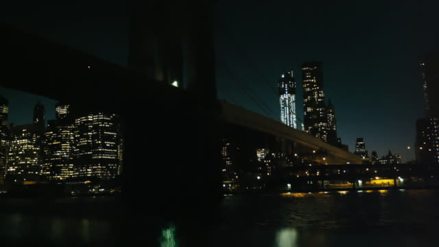Cruising under the Brooklyn Bridge, New York, at night