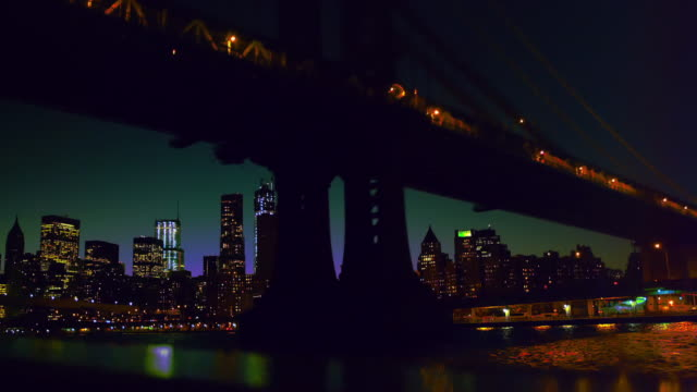 Cruising under the Manhattan Bridge, New York, at night