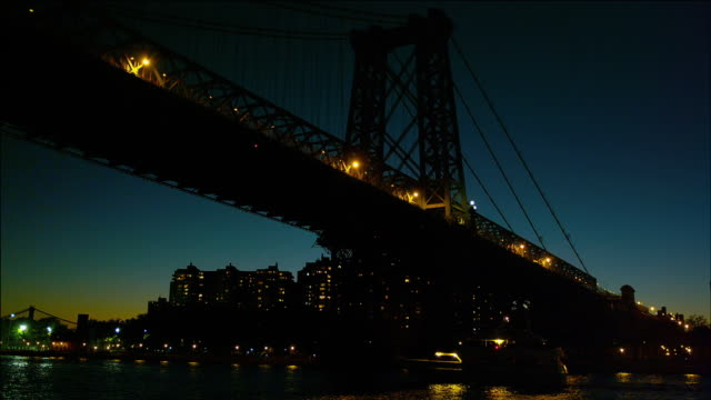 Cruising under the Williamsburg Bridge, New York, at night