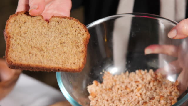 crumbled bread on a bowl - crumb stock videos & royalty-free footage