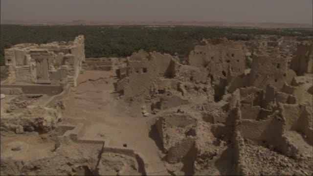 crumbling buildings comprise a ruined city in egypt. - adobe bildbanksvideor och videomaterial från bakom kulisserna