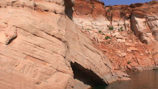 crumbling sandstone cliffs - lake powell stock videos and b-roll footage