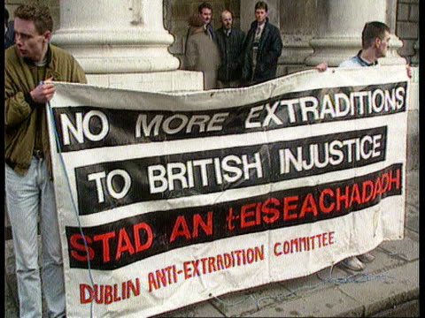 crumlin road escapees: extradition; republic of ireland: dublin: ext cms anthony sloan and another track back as towards large long banner held by... - dublin republic of ireland stock videos & royalty-free footage