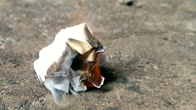crumpled paper slowly burning - crumpled paper stock videos and b-roll footage