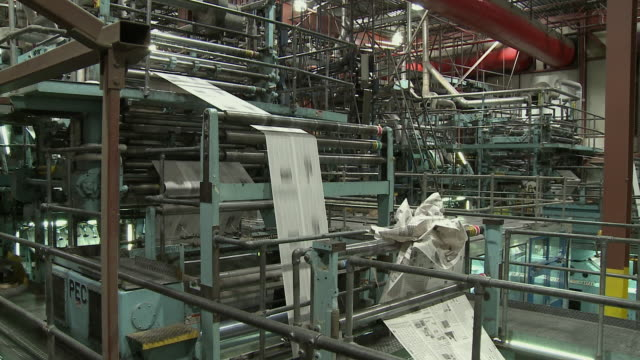 MS Crunched up paper in running printing press, San Francisco, California, USA / AUDIO