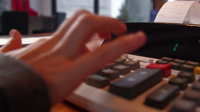 crunching numbers on calculator - rechenmaschine stock-videos und b-roll-filmmaterial