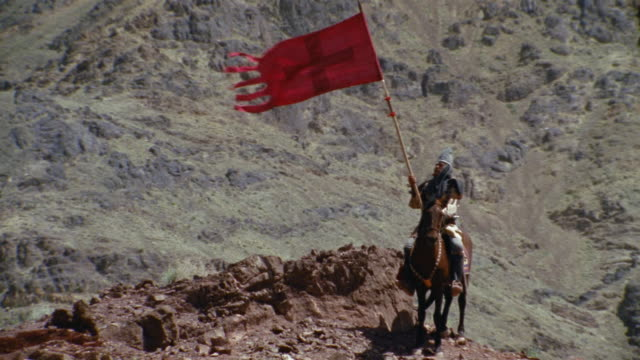 REENACTMENT MS TU TD Crusader on horse standing in mountain landscape in Middle Ages / Iran