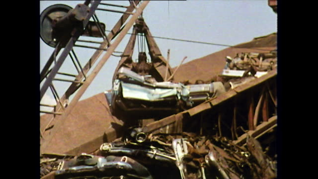 crushed blue car being moved by mechanical grabber; 1972 - decline stock videos & royalty-free footage