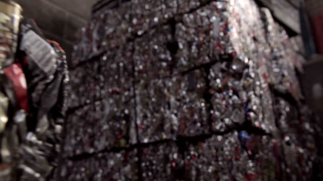 Crushed cans in cubic bales stacked up