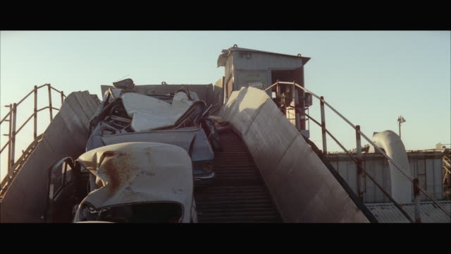ws tu crushed cars on conveyor belt to hopper of auto wrecking - 1972 stock videos and b-roll footage