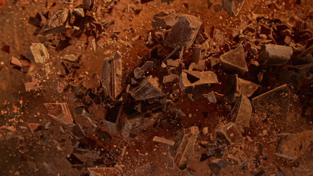 slo mo ld crushed chocolate flying into the air - chocolate stock videos & royalty-free footage