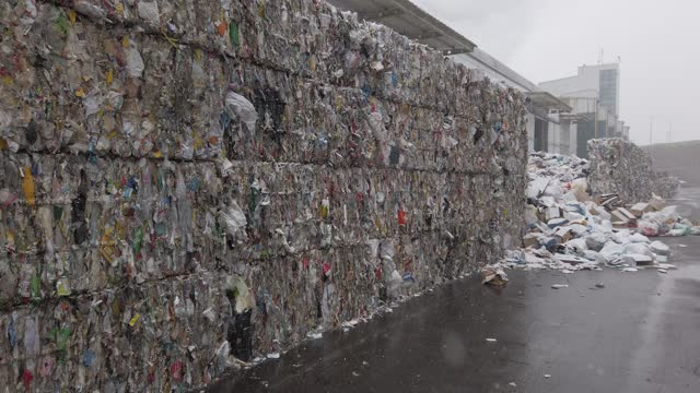 crushed plastic bags and bottles are stacked at a facility that stores recyclable materials following the lunar new year's holiday on february 16,... - capodanno coreano video stock e b–roll