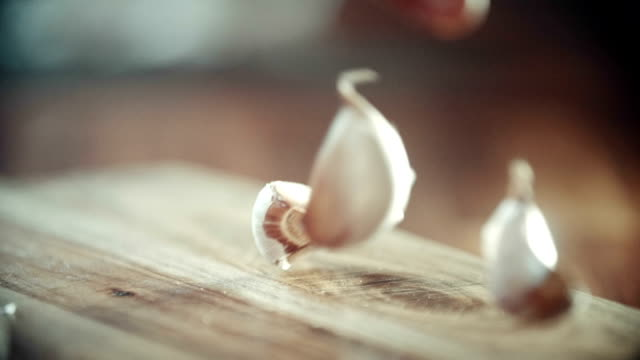 crushing and squeezing garlic on kitchen board - chopping stock videos & royalty-free footage