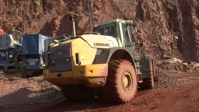 MS Crushing machine at quarry bulldozer moving Stone soil / Taben-Rodt, Rhineland-Palatinate, Germany